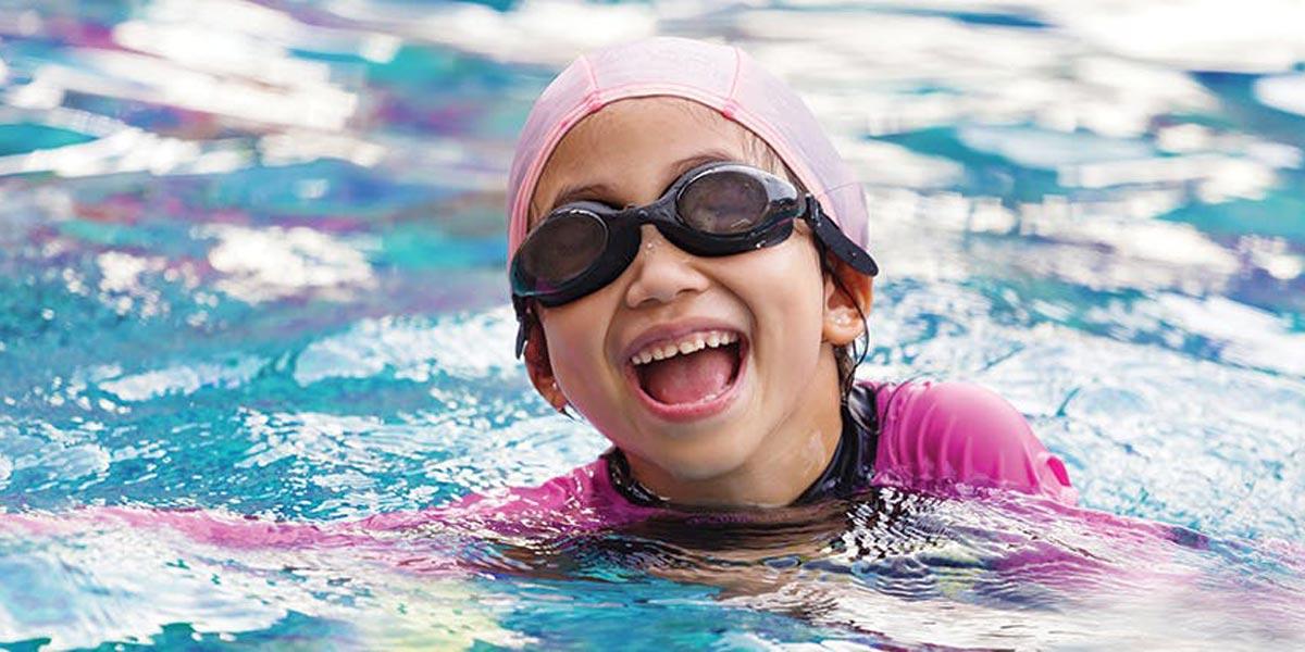 Girl smiling in pool