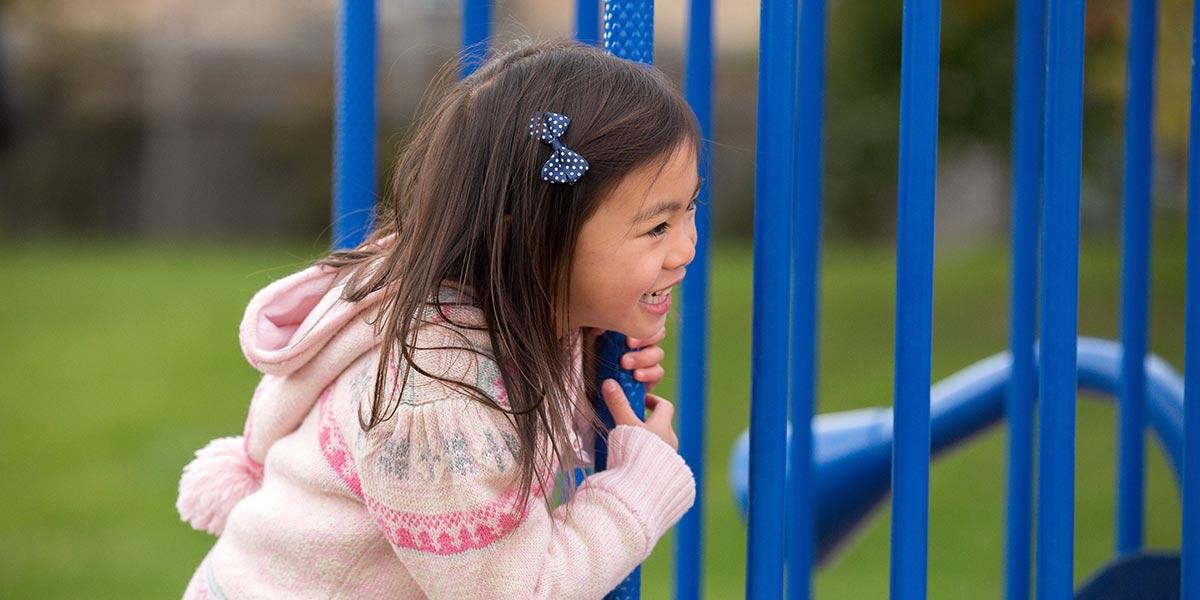 Girl playing on playground