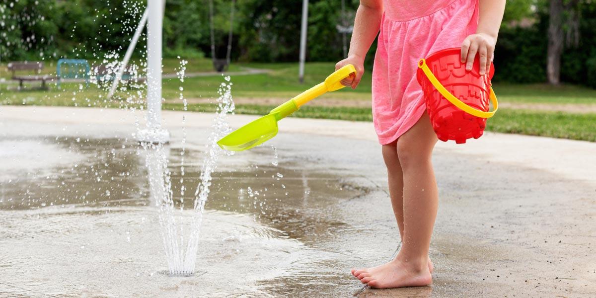 Young person at splash pad