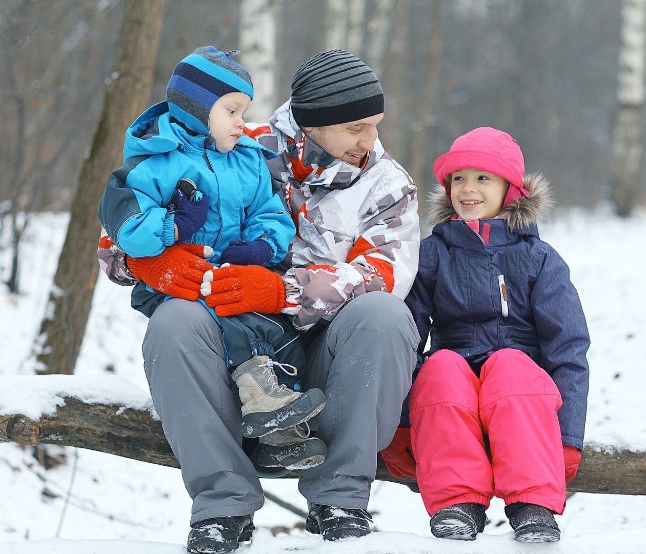 Family sitting outside in the winter